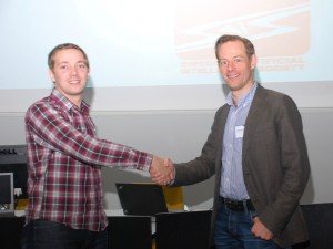 Fredrik Heintz congratulates Mattias Tiger to winning the SAIS Best AI Master's Thesis Award